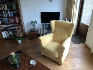 Herstoffering fauteuil